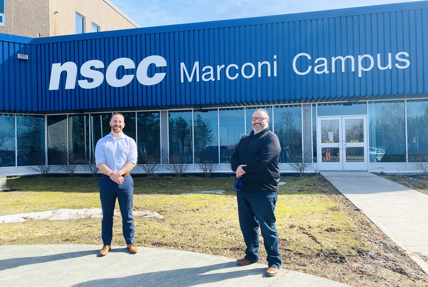 Michael Keating, left, and the principal of NSCC Marconi Campus Fred Tilley, stand outside the Nova Scotia Community College (NSCC) location on March 31. CONTRIBUTED