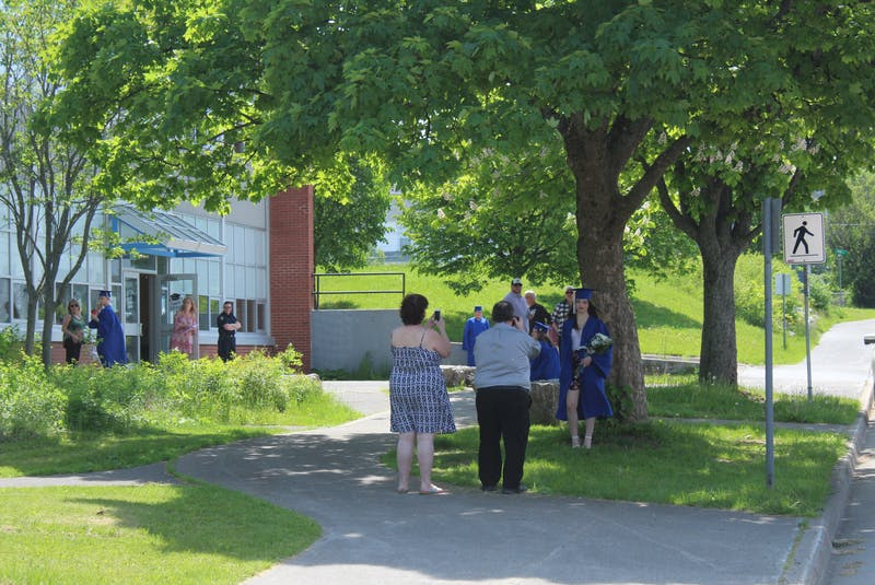 Then 18, Brianna Jackson stands for photos outside Sydney Academy in June 2020, while she waits for her appointment time for her graduation ceremony. Due to the COVID-19 pandemic, graduation was done by appointment only and only five people could attend at a time. CAPE BRETON POST FILE PHOTO