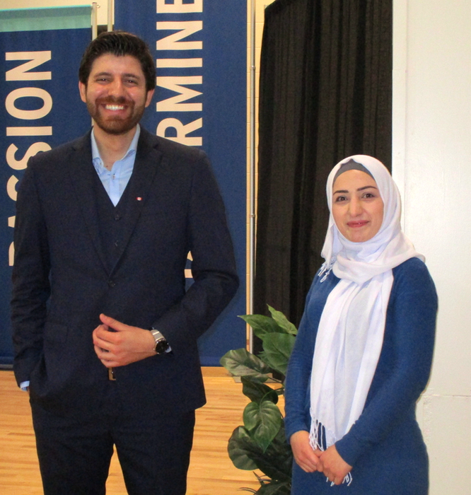 Peace by Chocolate founder and CEO Tareq Hadhad spoke inspiringly at Kingstec last February and posed with fellow Syrian and Kingstec business student Nahed Osman. - Contributed