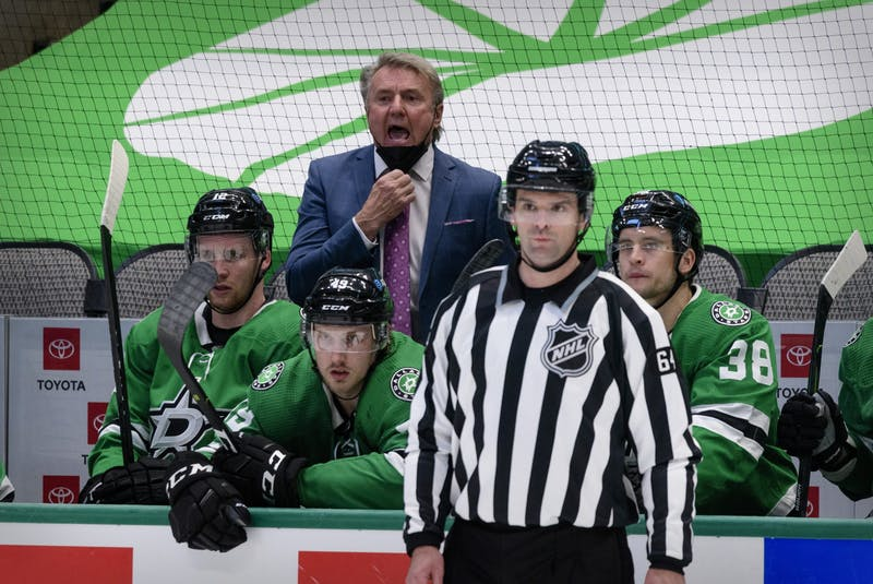 Despite having already received both vaccines, Dallas Stars coach Rick Bowness (centre) left the bench after the second period of this 1-0 loss to the Carolina Hurricanes due to COVID protocols. - Jerome  Miron