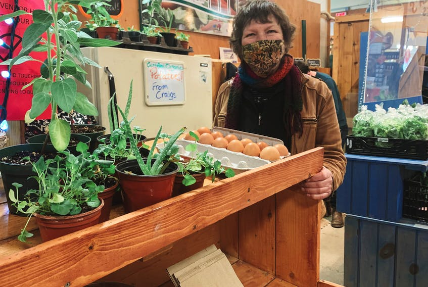 Judy Loo sells her produce at a farmers' market recently. Loo, a farmer at family-owned Springwillow Farm in Kensington, P.E.I., says a UN conference she attended on agricultural diversity and sustainability opened her eyes to food waste in Canada.
