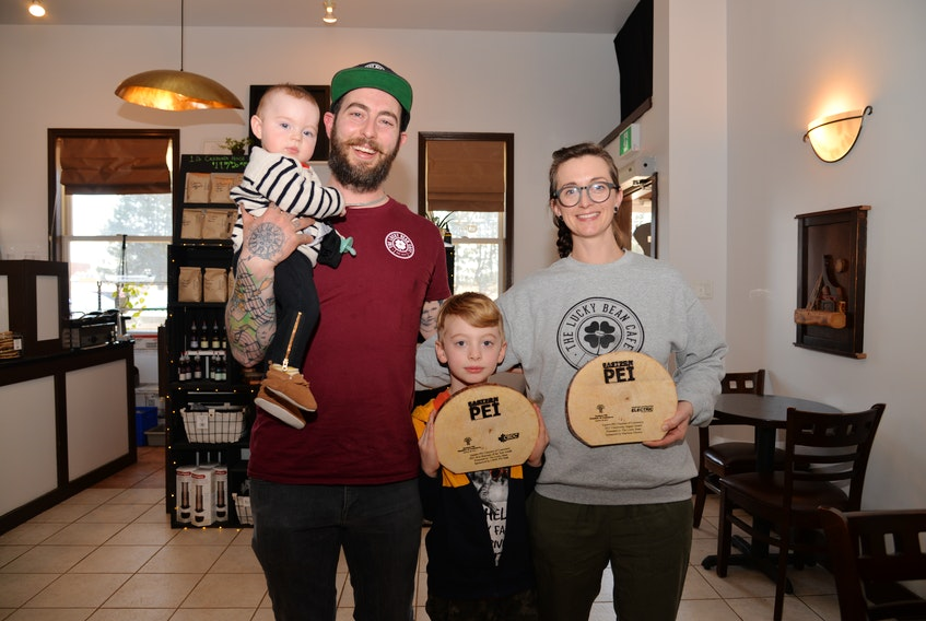 The Lucky Bean Cafe in Montague and Stratford won two Eastern P.E.I. Chamber of Commerce awards recently for new business and community impact. Shown, from left, are Matt Clendinning holding seven-month-old Violet (Baby Bean), along with Griffin and Tiffany, who are holding the two awards.