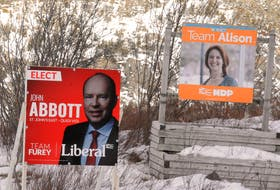Campaign signs for St. John's East-Quidi Vidi Liberal John Abbott and New Democratic Party Leader Alison Coffin during the election. Joe Gibbons/The Telegram