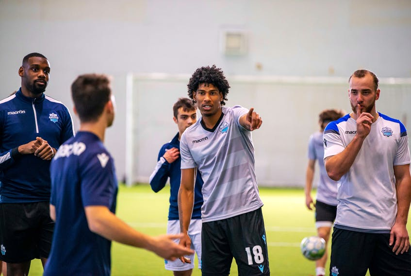 HFX Wanderers midfielder Andre Rampersad directs his teammates during a team pre-season training camp at the BMO Soccer Centre in Halifax - Trevor MacMillan