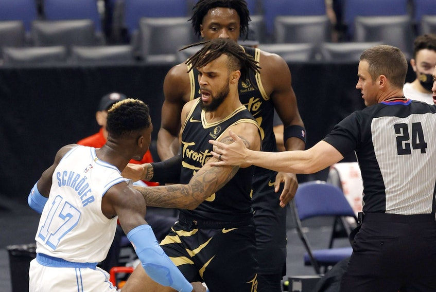 Lakers guard Dennis Schroder (17) and Toronto Raptors guard Gary Trent Jr. (33) push each other as Schroder gets ejected on Tuesday night.