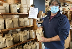 Brett Bunston says sales of his freshly-roasted coffee beans have taken off at his shop, the Caledonia House, at the Charlottetown Farmers' Market since the COVID-19 pandemic. On the flip side, single-cup sales have drastically fallen off.