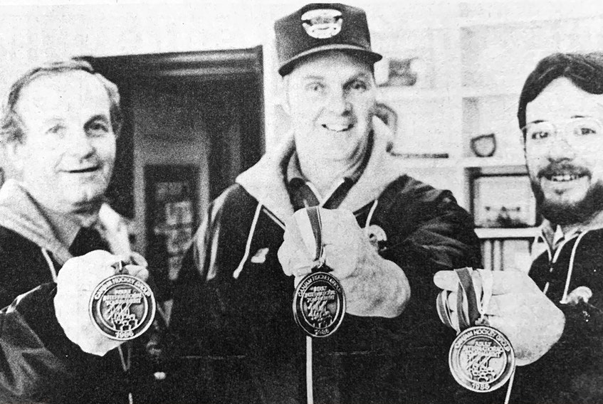 Clarence Redden, Ernie Hunt and Junior Moore were all smiles when displaying their silver medals after returning from the 1986 CAN/AM International Gentlemen's Hockey Tournament in Quebec City. The Windsor Moosehead Exports gentlemen's hockey team lost in the gold medal game 5-4.