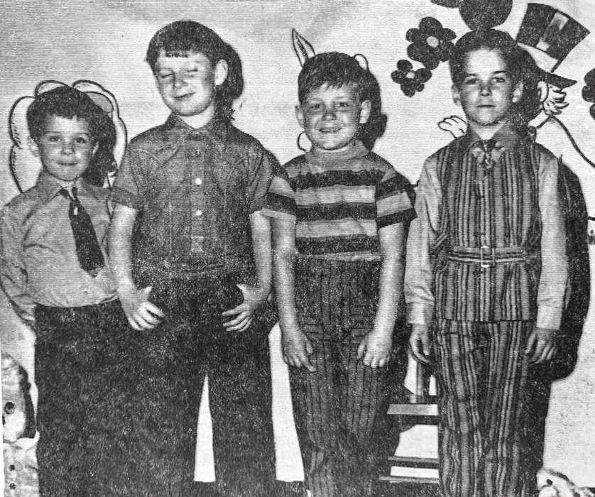 These sharp-dressed boys, from left, Paul Burgess, Grant Burgess, Kenneth Warren and Kenneth Anthony participated in an Anglican church fashion show fundraiser in 1971. - File Photo