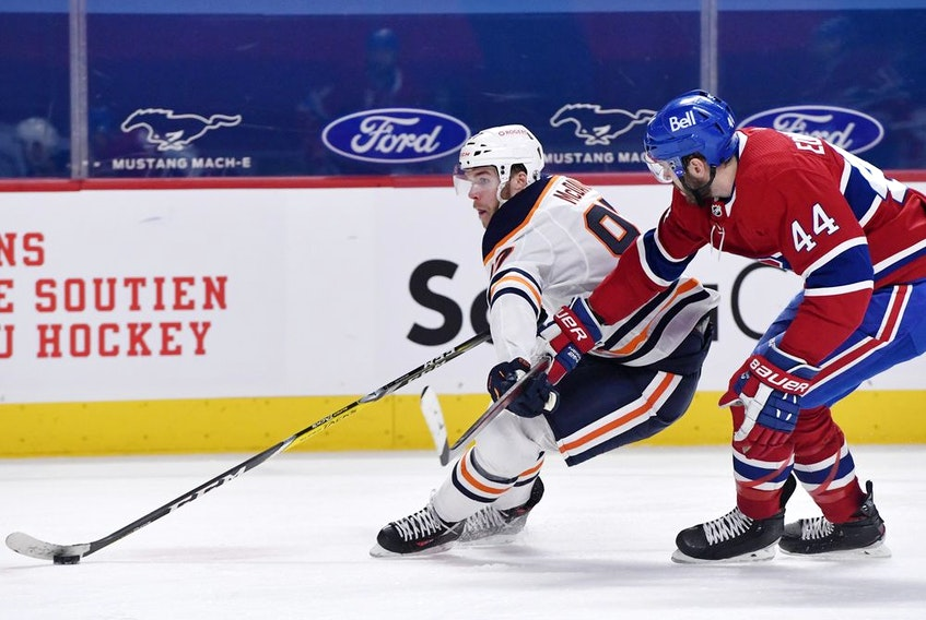 Edmonton Oilers forward Connor McDavid goes by Montreal Canadiens defenceman Joel Edmundson during the second period at the Bell Centre on April 5, 2021.