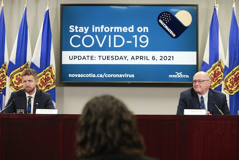 Nova Scotia Premier Iain Rankin, left, and chief medical officer of health Dr. Robert Strang attend a health briefing in this file photo.