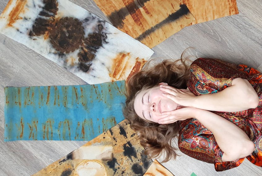 Textile artist Josephine Clarke is surrounded by some of her creations. CONTRIBUTED