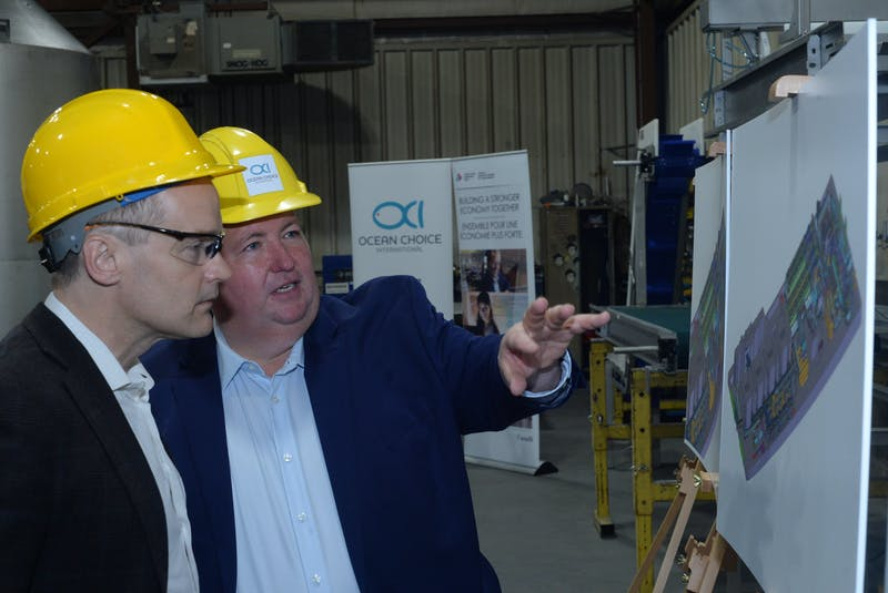At a 2018 news conference, Blaine Sullivan (right), president of Ocean Choice International, discusses plans for the company's new fishing vessel, the Calvert, with St. John's South-Mount Pearl MP Seamus O'Regan at the C & W Industrial Fabrication and Marine Ltd. facility in Bay Bulls. — File