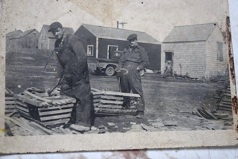 Fred Peach, left, who built the house in 1910, in his yard in 1946 building lobster traps with his brother Melvin Peach. Grandson Stan Peach says the backyard was not only a good size at one time and housed a cow and chickens, but there was even a road behind it where fishermen would take their lobster traps by horse and buggy to the wharf. CONTRIBUTED