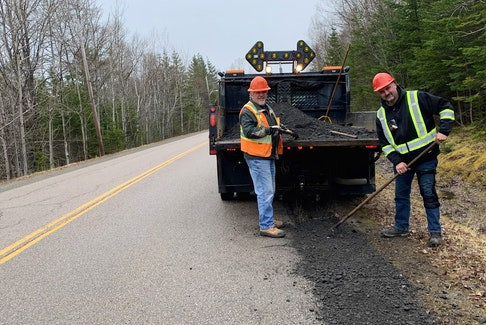 Parker MacLeod, left, and Lance Beck of the Nova Scotia Department of Transportation and Infrastructure Renewal fill in the shoulder of the road in Coxheath on Wednesday. Chris Connors • Cape Breton Post