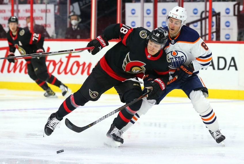 Tim Stützle #18 of the Ottawa Senators battles for the puck against Kyle Turris #8 of the Edmonton Oilers in the second period at Canadian Tire Centre on April 7, 2021 in Ottawa.