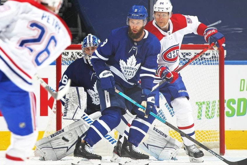 Corey Perry of the Montreal Canadiens watches an incoming shot against Jake Muzzin and Jack Campbell of the Toronto Maple Leafs at Scotiabank Arena on April 7, 2021 in Toronto, Ontario, Canada.