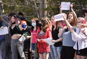 "Students walked out of West Kings District High School in Auburn on Thursday afternoon in support of a female student who says she was suspended after bringing to light a shirt a male student was wearing which read ""'Tis the season to be rapey."" - Ashley Thompson"