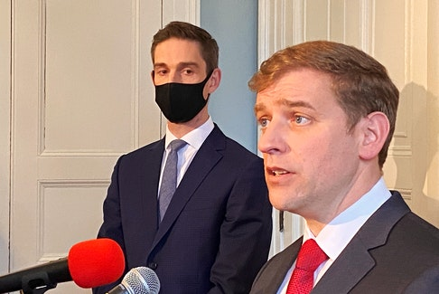 Newly sworn-in Newfoundland and Labrador Premier Andrew Furey is flanked by Justice Minister John Hogan during a media scrum Thursday morning at Government House in St. John's.