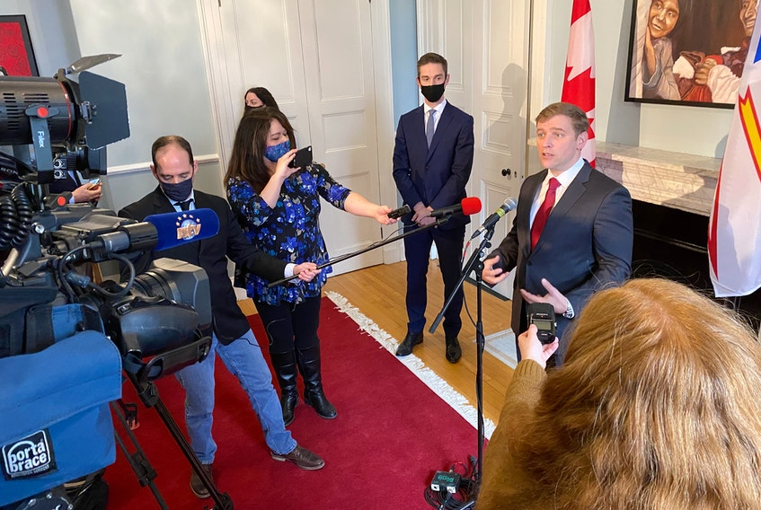 Andrew Furey speaks to members of the media after being sworn in as Newfoundland and Labrador's 14th premier. Furey's cabinet was also sworn in by Lt.-Gov Judy Foote at Government House in St. John's