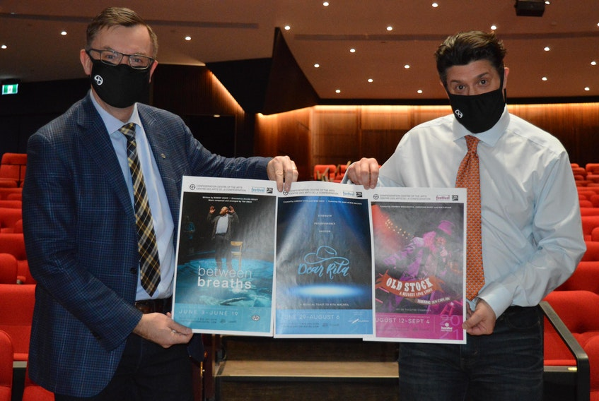 Steve Bellamy, left, CEO of the Confederation Centre of the Arts, and Adam Brazier, artistic director of the Charlottetown Festival, display posters for the three shows that will be featured on stage in the Homburg Theatre. The shows are, from left, Between Breaths, Dear Rita and Old Stock: A Refugee Love Story.