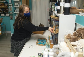 Erin Dawe works in her new shop Momma Bears Boutique at Paddler's Cove in Dartmouth on Thursday, April 8, 2021.