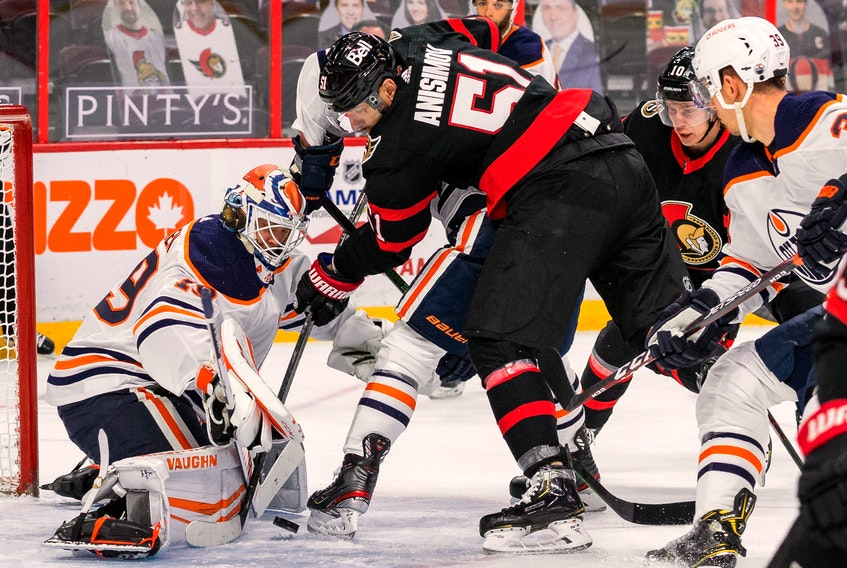 Senators centre Artem Anisimov (51) digs for a rebound off of Edmonton Oilers goaltender Mikko Koskinen during the first period on Wednesday at the Canadian Tire Centre.