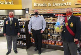 Royal Canadian Legion Breton branch 008 along with Sobeys North Sydney recently presented fruit baskets to branch veterans as a thank you for their service. Left to right, president Bill Lannigan, store manager Gerald Ford and sergeant-at-arms George MacIntosh. Contributed