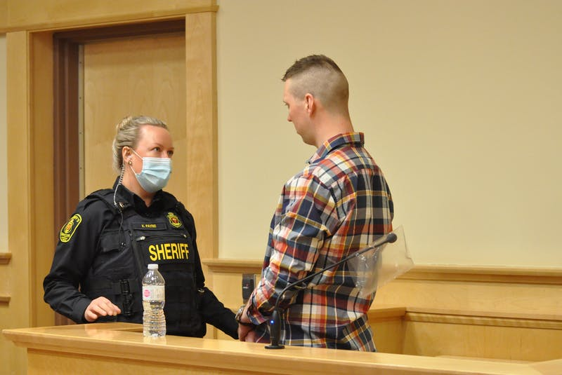 Sheriff officer Kayla Payne (left) explains what will happen next as Thomas Whittle is taken into custody after submissions on sentencing were made in his trial in Newfoundland and Labrador Supreme Court in Corner Brook on Thursday. — Diane Crocker