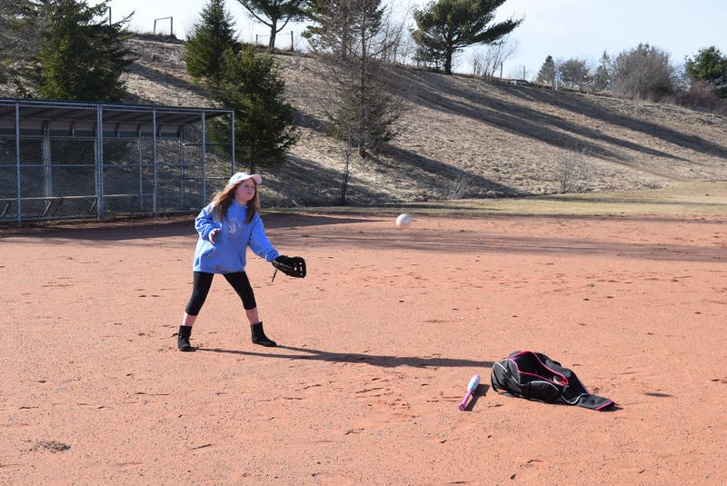 Rhaina Dykeman, 9, practices her catching skills. She took part in Canadian Girls Baseball when it debuted in Truro two years ago.  - Chelsey Gould