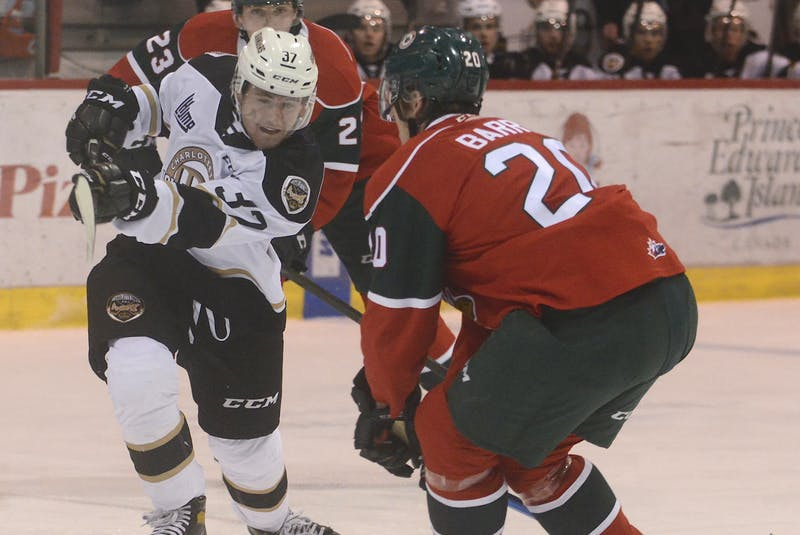 Charlottetown Islanders winger Bailey Peach fires a shot on the Halifax Mooseheads goal while being defended by Herd captain Justin Barron Wednesday at the Eastlink Centre. - Jason Malloy • The Guardian