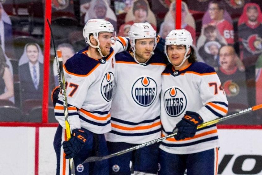 Edmonton Oilers Connor McDavid (97), Leon Draisaitl (29), and Ethan Bear celebrate Draisaitl's second goal of the game against the Ottawa Senators on April 7, 2021.