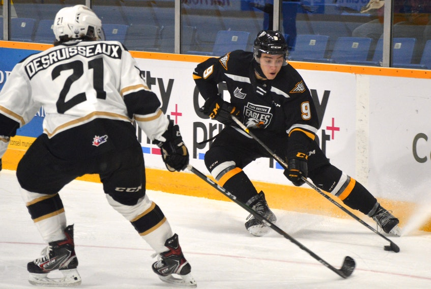 Jérémy Langlois of the Cape Breton Eagles, right, looks to make a play as he's watched by Cédric Desruisseaux of the Charlottetown Islanders during Quebec Major Junior Hockey League action earlier this season at Centre 200 in Sydney. Charlottetown is the top team in the Maritimes Division, while Cape Breton currently sits in sixth place. JEREMY FRASER • CAPE BRETON POST