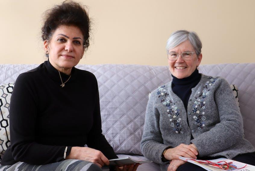 Farahnaz Rezaei, left, and Ann Boyles, right, are members of the Bahá'í faith community in P.E.I.
