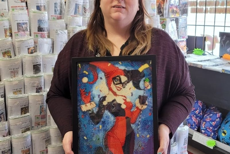 Andrea Edwards and her friend Toni Dinn McDonald (pictured) have come together to create a diamond art kit as a means of raising funds to assist Edwards as she battles cancer. Dinn McDonald is displaying a sample diamond art painting.  — Contributed