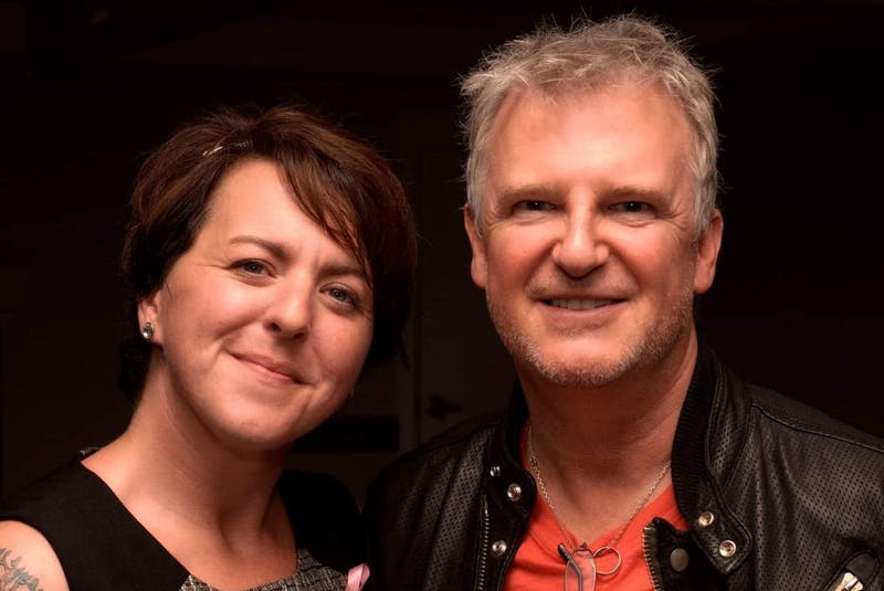 Andrea Edwards is pictured with Alan Frew of Glass Tiger during a fundraiser for the Atlantic Breast Cancer Foundation in 2013. Edwards says she has been involved with several large fundraisers over the years and finds it an odd experience now to be raising funds for herself. — Contributed