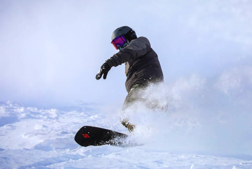 A snowboarder enjoys the excellent conditions in Paradise Bowl at Lake Louise Ski Resort west of Calgary.