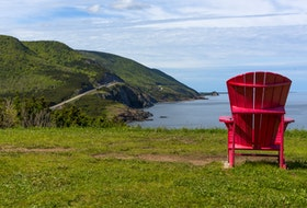 An adirondack chair at the coast in Petit Étang, Cape Breton Highlands National Park. STOCK