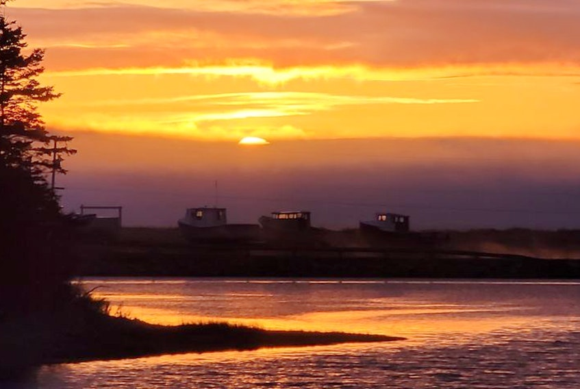 Mary Rankin MacDonald was at Little Judique Ponds in Inverness County, along Trans Canada Trail, when she saw these boats lining the shore waiting to be launched for the spring lobster season. She loved the look with the sunset in the background and decided to share it. Thank you, Mary.