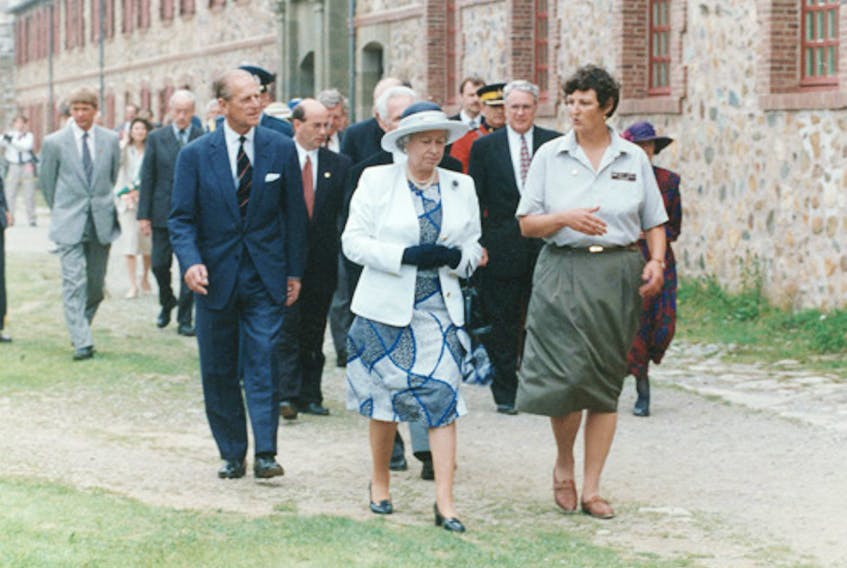 Queen Elizabeth and Prince Philip are given a royal walking tour of the grounds of the Fortress Louisbourg on Aug. 14, 1994, by Parks Canada guide Anne O'Neill. Prince Philip died Friday at the age of 99.