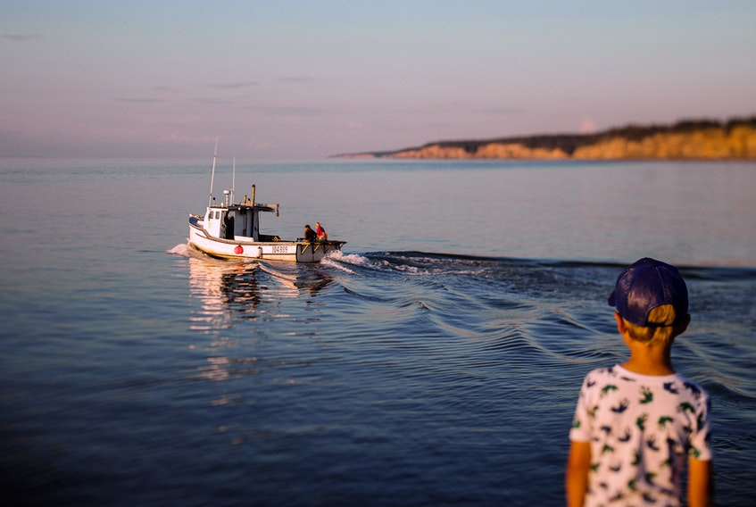 An idyllic Nova Scotia scene: The fishing vessel White Owl and its friendly crew chug into the sunset in Margaretsville. - Contributed