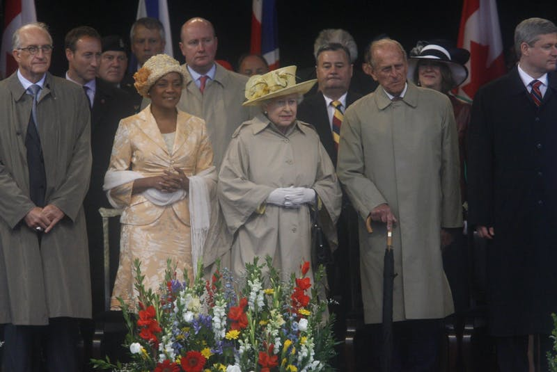 Queen Elizabeth and Prince Philip, flanked by Prime Minister Stephen Harper, right, Governor-General Michaelle Jean and her husband Jean-Daniel Lafonde stand on the stage during the official welcoming to Canada ceremony at Garrison Grounds in Halifax on Monday, June 28, 2010. - Herald file photo
