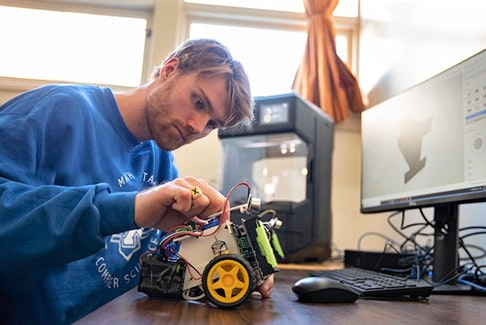 StFX computer science student Noah Barrett spent almost six months building a pair of robots for his honours thesis. STFX UNIVERSITY PHOTO