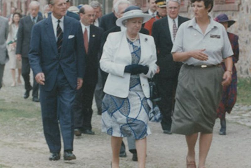 Queen Elizabeth and Prince Philip are given a royal walking tour of the grounds of the Fortress Louisbourg on Aug. 14, 1994, by Parks Canada guide Anne O'Neill. Prince Philip died Friday at the age of 99. (Nova Scotia Archives) - Contributed