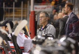 Charlottetown Islanders athletic therapist Kevin Elliott follows the play during a Quebec Major Junior Hockey League game at Eastlink Centre.