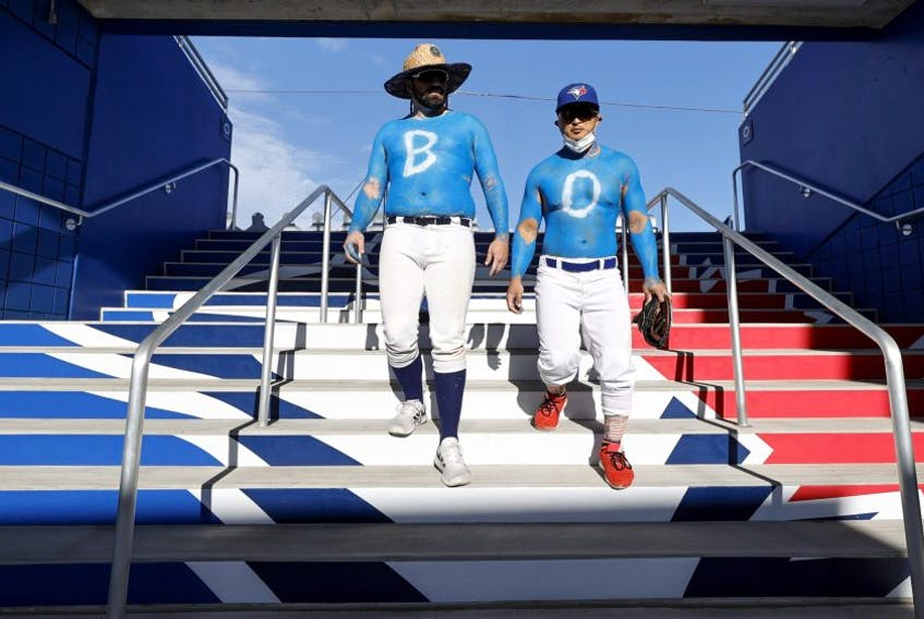 A pair of die-hard Jays fans arrive at TD Ballpark prior to the start of the Blue Jays-Angels game on Thursday night in Dunedin, Fla. GETTY IMAGES