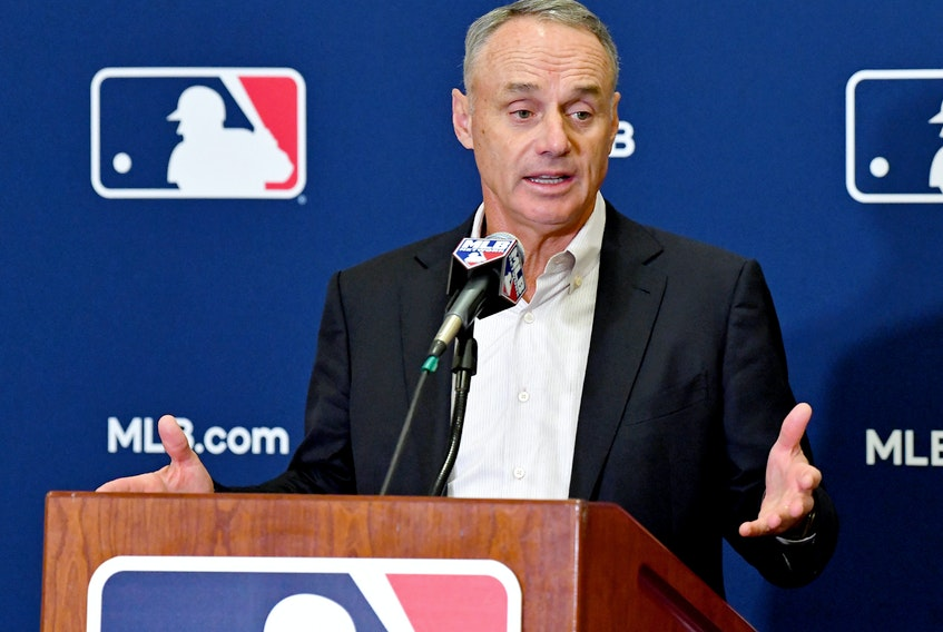 MLB commissioner Rob Manfred answers questions from the media during spring training media day in Arizona.