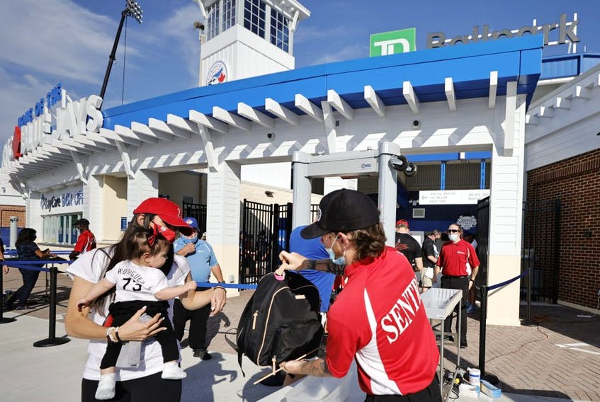 Security guards check bags at the entrance of TD Ballpark in Dunedin on Thursday. GETTY IMAGES