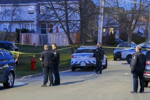 Halifax regional police work on Lahey Road at Clarence Street as they investigate reports of a shooting in Dartmouth, Thursday evening, April 8, 2021.