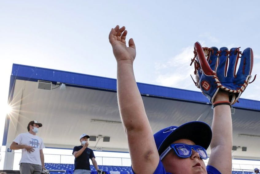"""Fans get settled in prior to the start of the game between the Blue Jays and Angels on Thursday. It was the """"home opener"""" for the Jays, who are playing their home matches in Dunedin for now. GETTY IMAGES"""