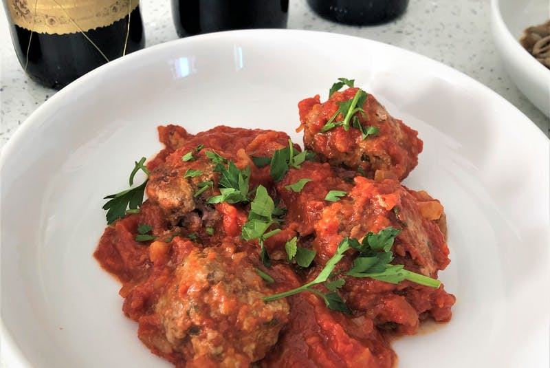 Tempranillo is a classic pairing for lamb cooked in a variety of ways. This meatball dish is inspired by the Spanish dish known as albondigas, more commonly made with pork or beef. Photo: Mark DeWolf - Mark DeWolf